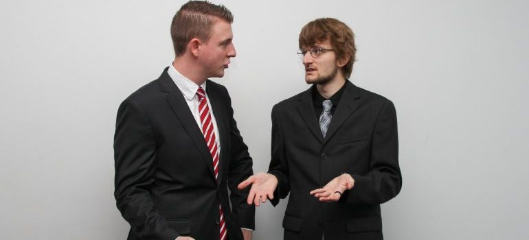 An image of tow businessmen arguing