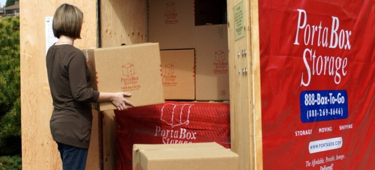 Woman loading an Everett self-storage PortaBox container