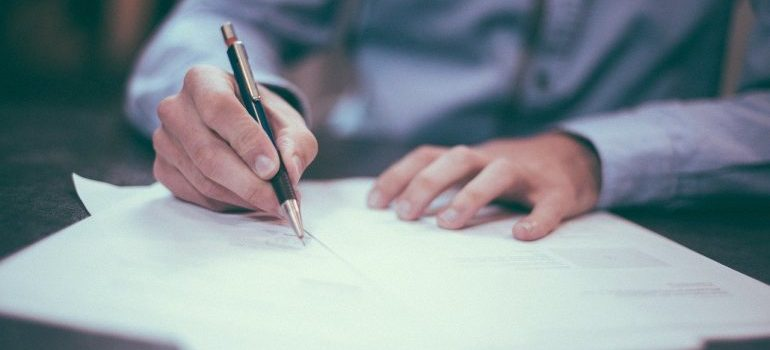 A man signing a contract.