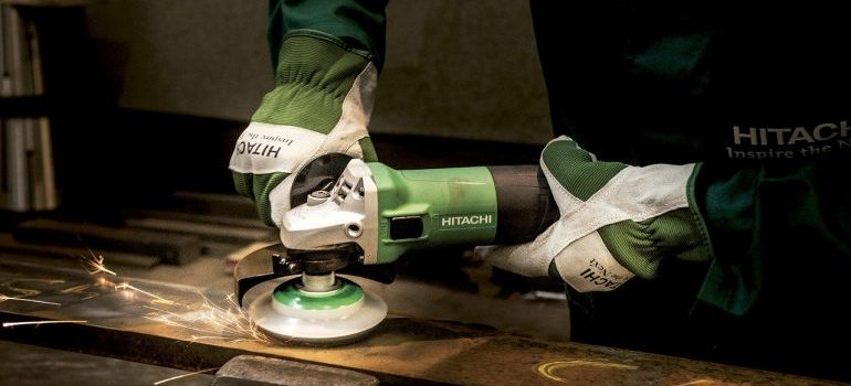 A person using a power tool.