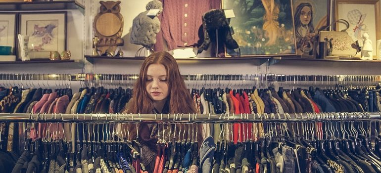 Person browsing a second hand shop.