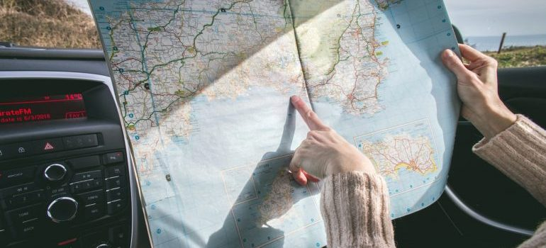 Woman pointing at map