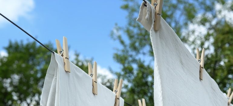 Sheets drying in preparation for storing linen clothing and bedding