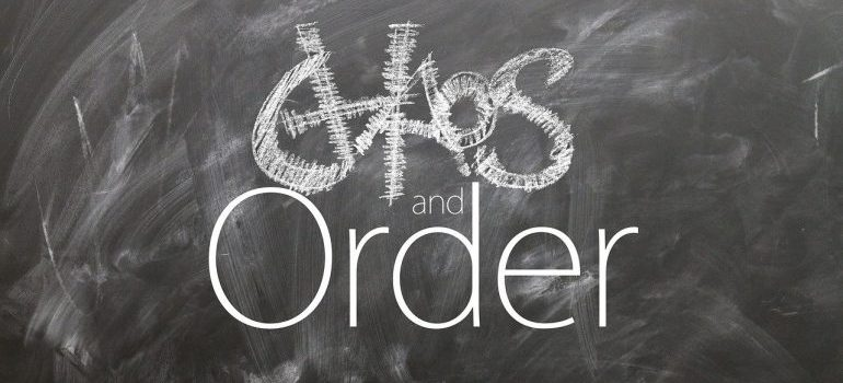 Chaos and order written on a blackboard.