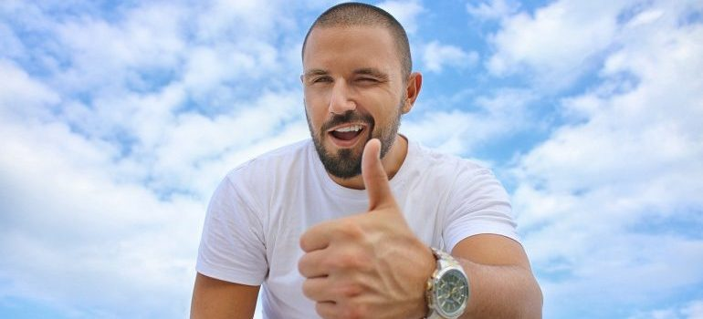 A man showing a thumbs up gesture.