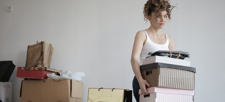 Woman getting rid of clutter.
