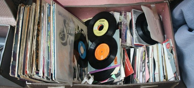Trying to store vinyl records in a suitcase.