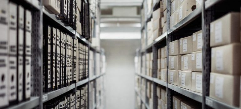Files on shelves after reorganizing your business with self storage.