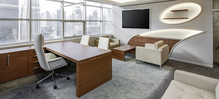 Modern office with white furniture.