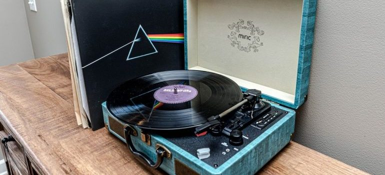 A vinyl record in a record player.