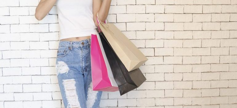 A girl holding shopping bags.