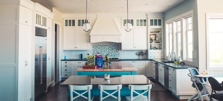 A clean and spacious kitchen as a product of decluttering your kitchen.