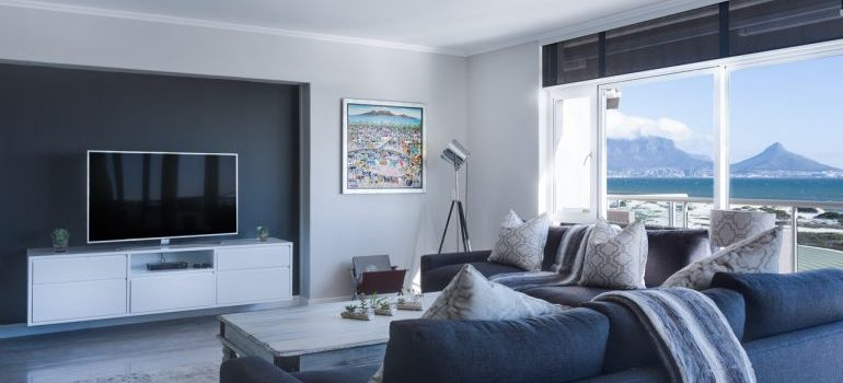 A light grey living room with mountain view.
