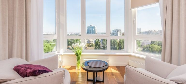 A bright beige room overlooking a city.