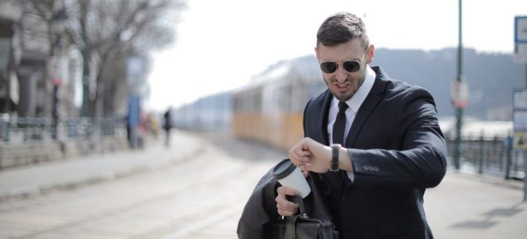 A businessman looking at the watch