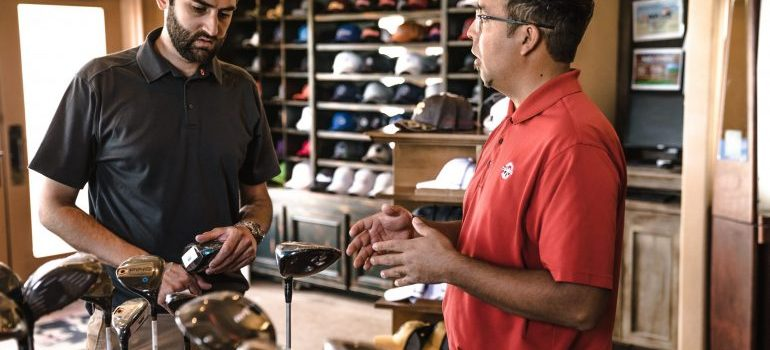 Two guys in a golf equipment store